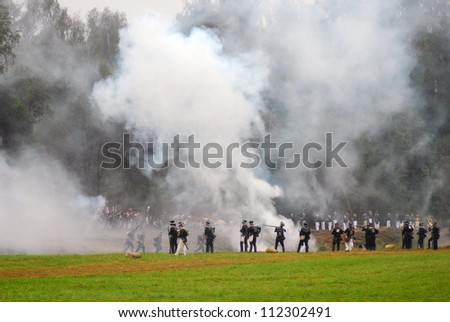 MOSCOW REGION - SEPTEMBER 02: Unknown soldiers fighting in fume at Borodino historical reenactment battle at its 200 anniversary. Taken on September 02, 2012 in Borodino, Moscow Region, Russia.