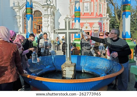 MOSCOW REGION, SERGIYEV POSAD, RUSSIA - MAY 1, 2014: Trinity Lavra of St. Sergius - the largest Orthodox male monastery in Russia. Water chapel-canopy, parishioners are gaining Holy water - stock photo
