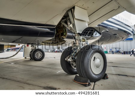 Moscow region, Vnukovo, Russia - September 10, 2016: Close-up view of main landing gear of Boeing 737-7JR BBJ N92SR shown during Jetexpo-2016 at Vnukovo international airport.