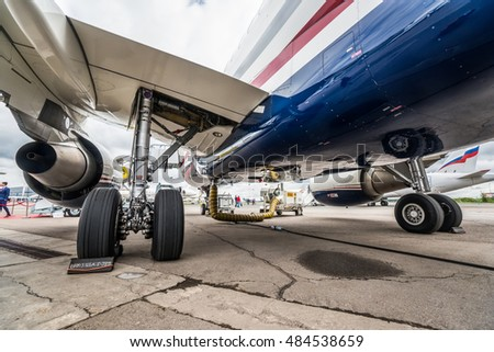 Moscow region, Vnukovo, Russia - September 09, 2016: Close-up view on main landing gear of private jet Airbus ACJ319 OE-LJG shown during Jetexpo-2016 at Vnukovo international airport.