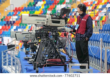 "MOSCOW, RUSSIA - APR 28: An unidentified video operator video tapes the 2011 World Championship of Figure Skating at the Palace of sports ""Megasport"" on April 30, 2011 in Moscow, Russia. - stock photo"