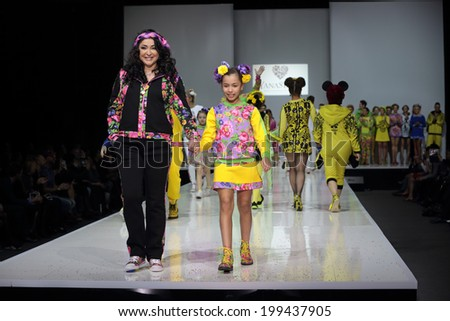 MOSCOW, RUSSIA - APR 1, 2014: Moscow Fashion Week in Gostiny Dvor. Demonstration models of clothes on the catwalk from Russian brand YanaStasia. Pop singer Lolita Milyavskaya