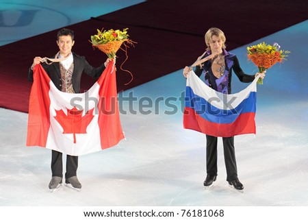 MOSCOW, RUSSIA - APR 28: Patrick Chan & Artur Gachinski (l-r) win gold and bronze medals in single man's competition at the 2011 World Championship of Figure Skating event on April 28, 2011 in Moscow, Russia. - stock photo
