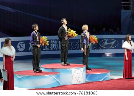 """MOSCOW, RUSSIA - APR 28: Winners of single man's 2011 World Championship of Figure Skating competition receive their awards at the Palace of Sports """"Megasport"""" on April 28, 2011 in Moscow, Russia. - stock photo"""
