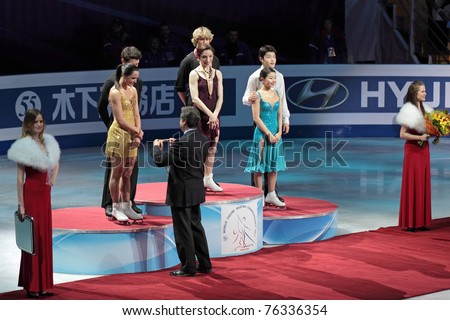 "MOSCOW, RUSSIA - APR 30: World championship on figure skating 2011. Ceremony of rewarding of winners in pair figure skating. Palace of sports ""Megasport"" on April 30, 2011 in Moscow. - stock photo"