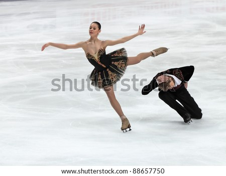 "MOSCOW, RUSSIA - APR 30: World championship on figure skating 2011. Nikita Katsalapov and Elena Ilinykh in pair ice dance. Palace of sports ""Megasport"" on April 30, 2011 in Moscow. - stock photo"