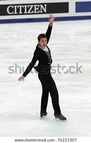 """MOSCOW, RUSSIA - APR 28: World championship on figure skating 2011. Patrick Chan - performance of the gold medallist in single man's figure skating. """"Megasport"""" on April 28, 2011 in Moscow - stock photo"""