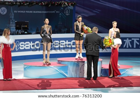 MOSCOW, RUSSIA - APR 30: World championship on figure skating 2011. Rewarding of winners in single ladies free figure skating. Yuna Kim,  Miki Ando and Carolina Kostner on April 30, 2011 in Moscow.