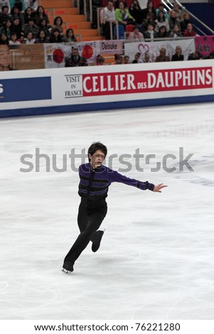 """MOSCOW, RUSSIA - APR 28: World championship on figure skating 2011. Takahiko Kozuka - performance of the silver medallist in single man's figure skating. """"Megasport"""" on April 28, 2011 in Moscow - stock photo"""
