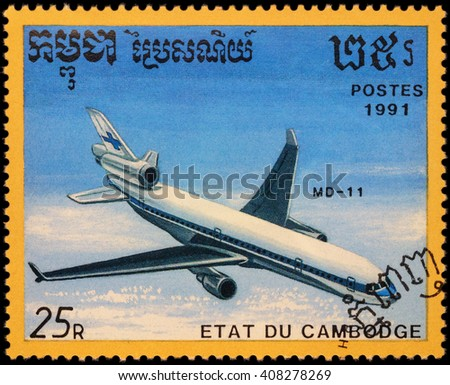 """MOSCOW, RUSSIA - APRIL 19, 2016: A stamp printed in Cambodia shows passenger aircraft McDonnell Douglas MD-11, series """"Airplanes"""", circa 1991 - stock photo"""