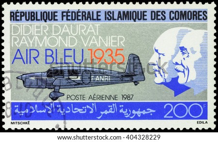 "MOSCOW, RUSSIA - APRIL 11, 2016: A stamp printed in Comoros shows old airplane and portraits of Didier Daurat and Raymond Vanier, devoted to the ""Air Bleu"", series ""Airmail - Aviation"", circa 1987 - stock photo"