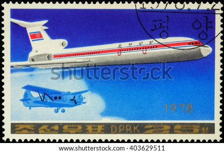 "MOSCOW, RUSSIA - APRIL 10, 2016: A stamp printed in DPRK (North Korea) shows Soviet passenger aircraft Tupolev Tu-154 and old airplane, series ""Airplanes"", circa 1978 - stock photo"