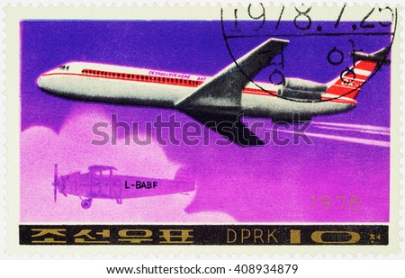 "MOSCOW, RUSSIA - APRIL 10, 2016: A stamp printed in DPRK (North Korea) shows soviet passenger aircraft Ilyushin Il-62M and old airplane, series ""Airplanes"", circa 1978 - stock photo"