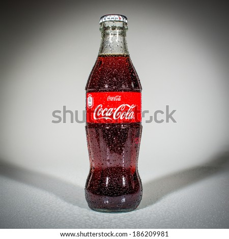 MOSCOW, RUSSIA-APRIL 4, 2014: Bottle of Coca-Cola. Coca-Cola is a carbonated soft drink sold in stores, restaurants, and vending machines throughout the world. - stock photo