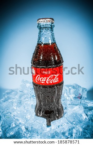 MOSCOW, RUSSIA-APRIL 4, 2014: Bottle of Coca-Cola on ice. Coca-Cola is a carbonated soft drink sold in stores, restaurants, and vending machines throughout the world. - stock photo
