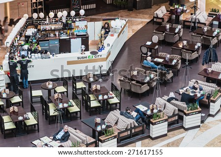 Moscow,Russia-April 19,2015:buyers are resting in a cafe in Afimall City.Shopping complex Afimall City is located in Moscow City. Area of Afimall 320,000 square metres.focus in the center of the frame