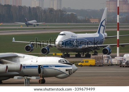 Moscow, Russia - April 28, 2014:Cargo airplanes Boeing 747-400 and Ilyushin 76 at Sheremetyevo cargo terminal.