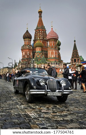 MOSCOW, RUSSIA - APRIL 24, 2010: Jaguar XK150 on the traditional spring rally of retro cars in Moscow. Start on the Red Square. - stock photo