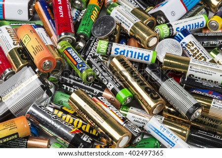 MOSCOW, RUSSIA - APRIL 07, 2016: Many used AA and AAA sized batteries in a pile. - stock photo