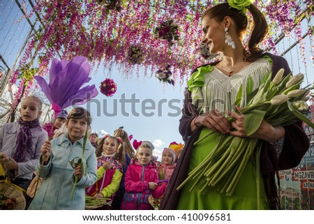 MOSCOW, RUSSIA - APRIL 23, 2016: People take part in a flower parade as part of the Moscow Spring festival in central Moscow, Russia - stock photo
