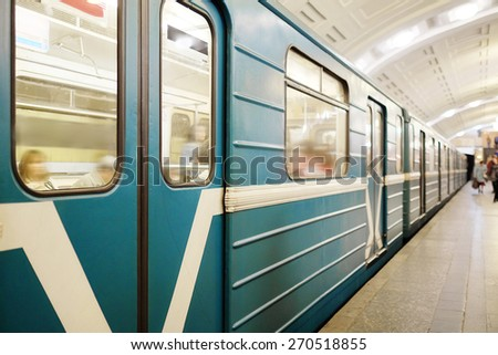 "MOSCOW, RUSSIA  -  APRIL 12, 2015: Sokolnicheskaya line - the first line of the Moscow metro. Station of the Moscow metro ""Lenin Library"". Arrival of a train - stock photo"