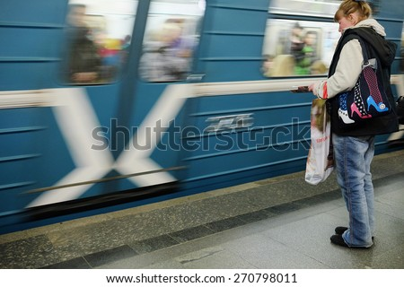 "MOSCOW, RUSSIA  -  APRIL 12, 2015: Sokolnicheskaya line - the first line of the Moscow metro. Station of the Moscow metro ""Lenin Library"". Arrival of a train"