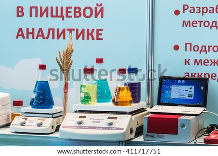 MOSCOW, RUSSIA - April 12,2016: 14th International Exhibition of laboratory equipment and chemical reagents in Moscow.Medical and laboratory equipment at the exhibition.Focus on of laboratory flasks - stock photo
