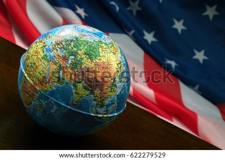 MOSCOW, RUSSIA - APRIL15,2017: The globe on the background of the American flag