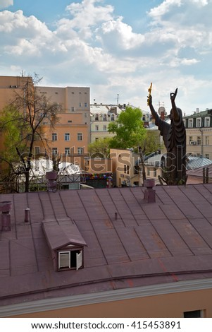 MOSCOW, RUSSIA - APRIL, 30. Top view of the huge sculpture of a praying woman and buildings around the courtyard of the Moscow Museum of Modern Art on April 30, 2014. Russia.