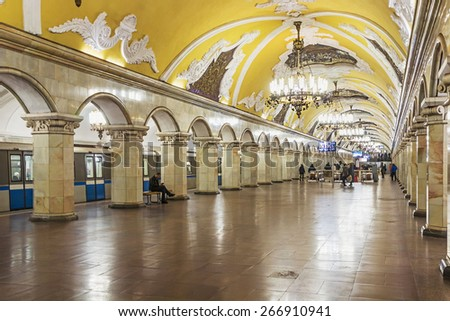 MOSCOW, RUSSIA - April 3, 2015: Tourists at the metro station Komsomolskaya in Moscow, Russia. Metro station Komsomolskaya is a monument of the Soviet era. - stock photo