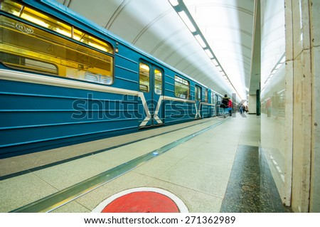 MOSCOW, RUSSIA - APRIL 17, 2015: Train and passengers  in subway station Mendeleevskaya in Moscow, Russia - stock photo