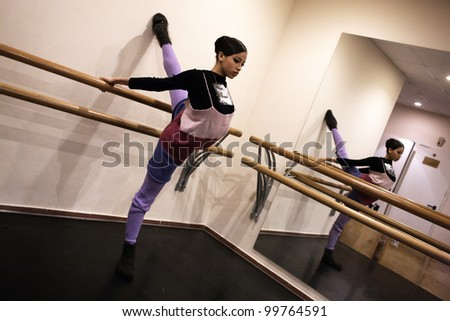 MOSCOW, RUSSIA - APRIL 3: Warm-up before show of Mikhailovsky theater ballet during Golden Mask contest. ?horeographer Nacho Duato. April 3, 2012 in Moscow, Russia. - stock photo