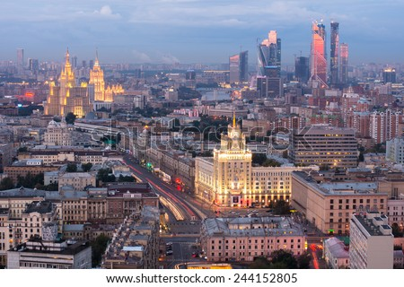 MOSCOW, RUSSIA - AUG 30, 2014: Cityscape with Stalinist skyscraper on Kudrinskaya street and Hotel Ukraina at night  - stock photo
