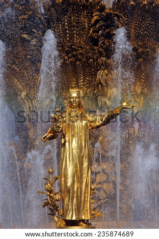 MOSCOW, RUSSIA - AUG 20, 2014: Woman symbolizing Tajikistan - part of the fountain Friendship of Nations (1954), All Russian Exhibition Center - stock photo