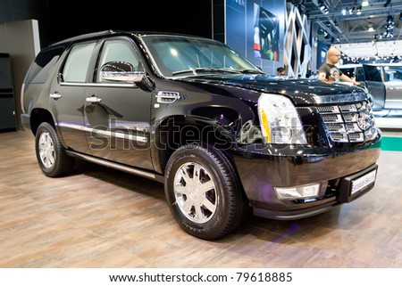 MOSCOW, RUSSIA - AUGUST 25:  Black SUV Cadillac Escalade on display at Moscow International exhibition InterAuto on August 25, 2010 in Moscow, Russia.