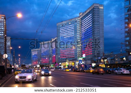 MOSCOW, RUSSIA - AUGUST 23, 2014: Buildings at New Arbat Street at evening. Illuminations in honor of the National Flag of the Russian Federation - stock photo