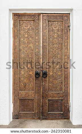 """Moscow, Russia -August 23, 2014: carved wooden door pavilion """"Culture"""" near VDNKh exhibition center, Moscow. Pavilion """"Culture"""" was built in 1954 as the pavilion """"Uzbek SSR"""" by architect S. Polupanova - stock photo"""