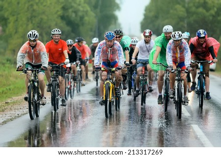 MOSCOW, RUSSIA - AUGUST 22: Charitable bicycle race from Kaluga to Moscow on August 22, 2014 .Russia. Cyclists compete in the rain - stock photo