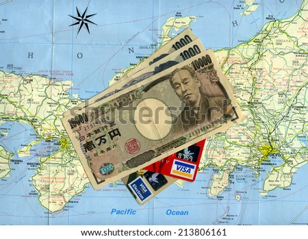 MOSCOW, RUSSIA - AUGUST 29, 2014: Concept traveling to Japan. Japanese money (yens), Visa credit cards, Japan map