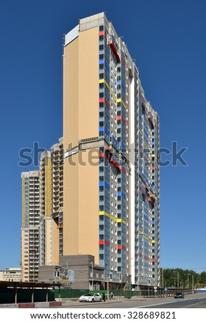 """MOSCOW, RUSSIA - AUGUST 28, 2015: Facade of new modern high-rise apartment buildings in Moscow on background of blue sky. Residential complex """"Spassky Bridge"""" - stock photo"""