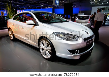 MOSCOW, RUSSIA - AUGUST 25:  Grey car Renault Fluence on display at Moscow International exhibition InterAuto on August 25, 2010 in Moscow, Russia. - stock photo