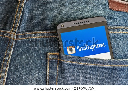 Moscow, Russia-August 26, 2014: instagram app open in the mobile phone HTC.HTC Corporation main direction rapidly developing market of smartphones. Instagram free application sharing photos and videos - stock photo