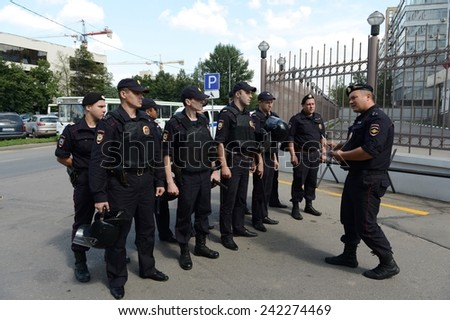 MOSCOW, RUSSIA - AUGUST 8, 2013:  Instructing police officers. Patrol and inspection service of the police provides public safety in the capital.
