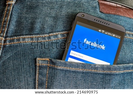 Moscow, Russia - August 26, 2014: mobile phone HTC and entrance to facebook. The biggest social network in the world. Was founded in 2004 by Mark Zuckerberg. - stock photo