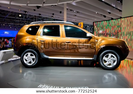 MOSCOW, RUSSIA - AUGUST 25:  Orange jeep car Renault  Duster on display at Moscow International exhibition InterAuto on August 25, 2010 in Moscow, Russia. - stock photo