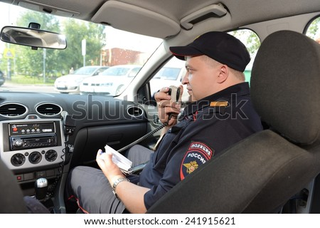 MOSCOW, RUSSIA - AUGUST 8, 2013:  Police in the patrol car. Patrol and inspection service of the police provides public safety in the capital.
