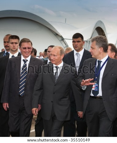 MOSCOW, RUSSIA, AUGUST,18: Prime Minister of Russia Vladimir Putin (c) at the International Aviation and Space salon MAKS,  August,18, 2009 at Zhukovsky, Russia - stock photo