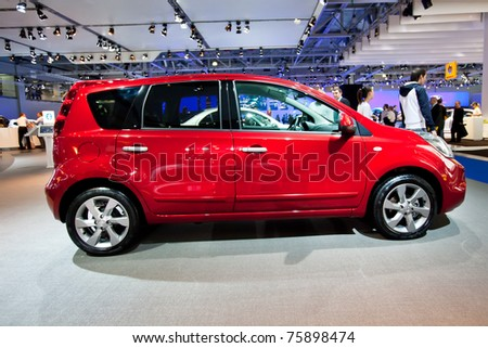 MOSCOW, RUSSIA - AUGUST 25:  Red car Nissan Note  on display at Moscow International exhibition InterAuto on August 25, 2010 in Moscow, Russia.