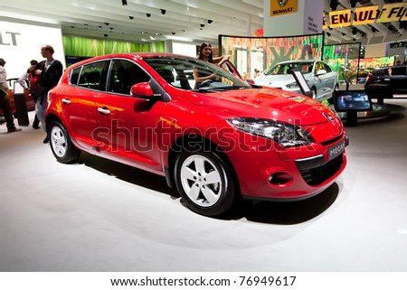 MOSCOW, RUSSIA - AUGUST 25:  Red car Renault Megane on display at Moscow International exhibition InterAuto on August 25, 2010 in Moscow, Russia. - stock photo