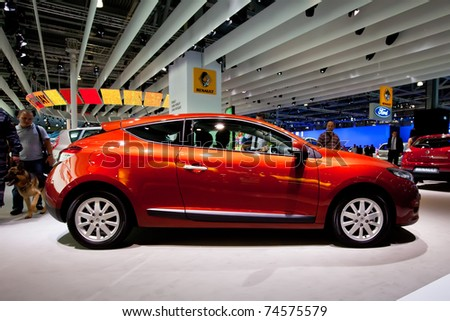 MOSCOW, RUSSIA - AUGUST 25:  Red car Renault Megane on display at the Moscow International exhibition InterAuto on August 25, 2010 in Moscow, Russia. - stock photo